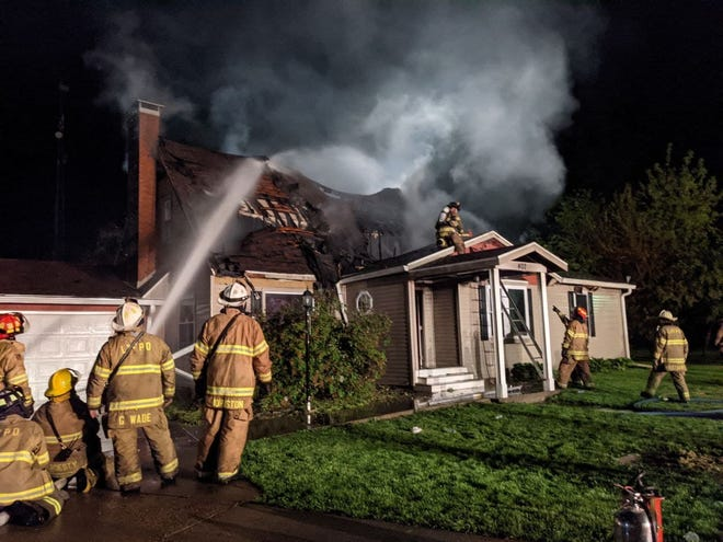 Monmouth firefighters responded early Sunday to a house fire at 407 N. 10th St. A pet suffering from smoke inhalation was rescued at revived at the scene.