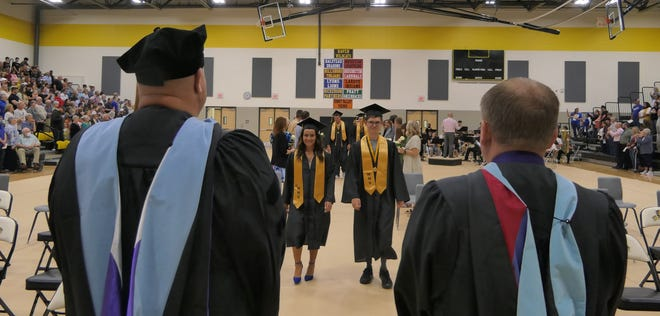 Haven High School graduates walk to their seats during their graduation ceremonies on May 16, 2021.
