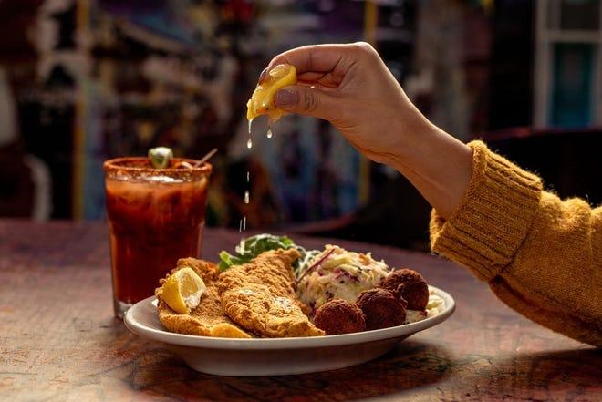 Fried catfish with Cajun coleslaw and hushpuppies at Jazz a Louisiana Kitchen