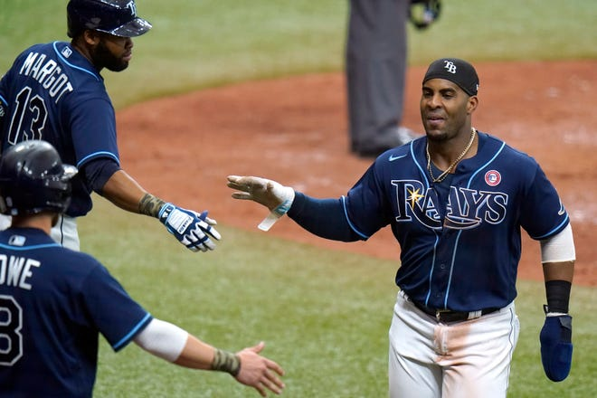 Tampa Bay Rays' Yandy Diaz celebrates with Manuel Margot (13) and Brandon Lowe (8) as he scores on a two-run double by Joey Wendle off New York Mets relief pitcher Jeurys Familia on Saturday.