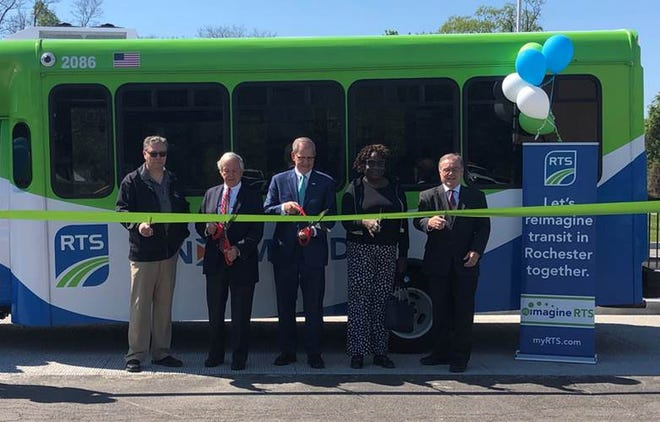 Rochester-Genesee Regional Transportation Authority commissioners Geoff Astles (vice chairman), Jacques Chapman, Don Jeffries (chairman) and Jerdine Johnson join Regional Transit Authority CEO Bill Carpenter for the launch of Reimagine RTS, the redesign of the transit system in Monroe County. Pictured, from left, are Chapman, Jeffries, Carpenter, Johnson and Astles.
