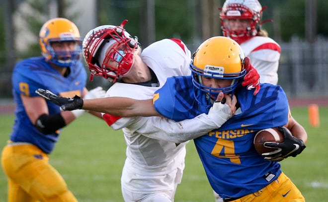 Jefferson's Nolan Vanover is tackled by Connor McCraight of New Boston Huron. Vanover has been selected to play in the Michigan High School Football Coaches Association All-Star Game.