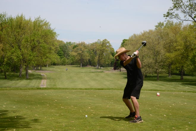 Milan's Tyler Helzerman tees off during the Monroe County Golf Championship at Monroe Golf & Country Club last month.