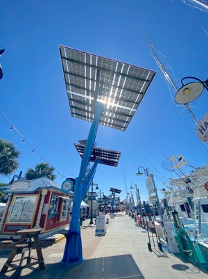 TheHarborWalk Village Adventures area has a new attraction — two Gulf Power solar trees that provide shade, phone charging,color-changing lights and a spot for visitors to take a selfie with eye-catching solar technology producing clean electricity.