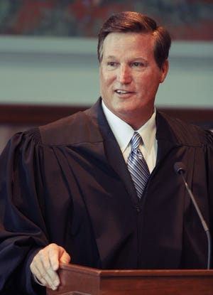 In this archive photo, Tim Henderson is shown at his judicial swearing-in ceremony in 2012. He resigned this year after being accused of sexual misconduct.