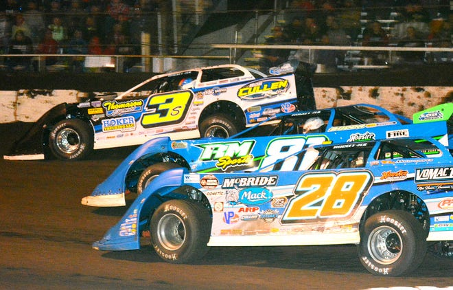 """Brian Shirley (3) leads Tanner English (81) and Dennis Erb Jr. (28) in the closing laps of the $15,000 MARS sanctioned """"Spring Showcase"""" Saturday at Fairbury Speedway."""