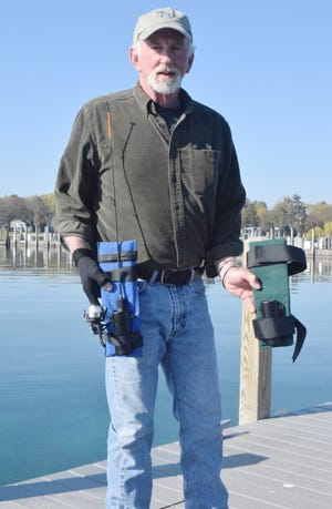 Petoskey resident Pat McKee displays two of his fishing rod-holding devices aimed at helping those with disabilities still enjoy all the thrills of casting, reeling and jigging.