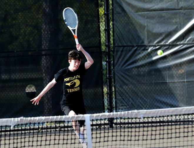 Portsmouth's Ryan Porter returns a shot to Winnacunnet's Shay Leno during their No. 1 singles match on Monday afternoon. Portsmouth improved to 7-0 with a 9-0 win over the Warriors.