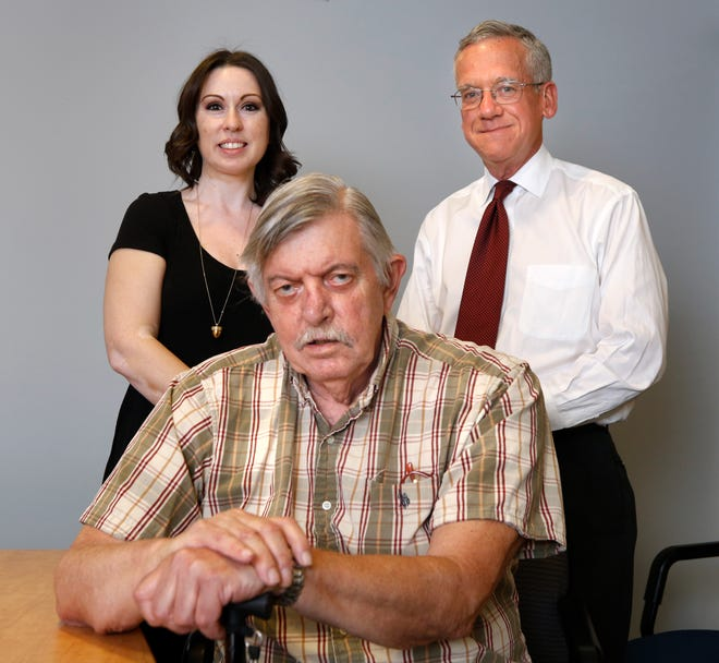 """Edward Caniglia with lawyers Rhiannon SelinaHuffman and Thomas W. Lyons III, whom he refers to as his """"heroes."""""""