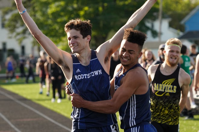 Rootstown's Evan Piscitani, left, and Donovan Birkett celebrate a 4x400 victory at the PTC championships.