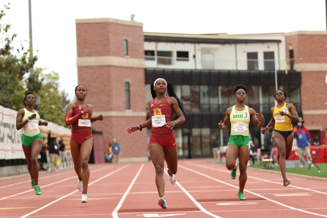 TeeTee Terry leads USC to victory in the 200 ahead of Oregon's Kemba Nelson Sunday during the Pac-12 Track & Field Championship meet at Loker Stadium in Los Angeles.
