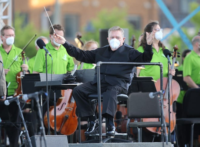Gerhardt Zimmermann serves as guest conductor of the Tulsa Symphony Orchestra last week during a special performance at ONEOK Field. Zimmermann will be conducting the first in-person performance of the Canton Symphony Orchestra on Sunday since the pandemic.