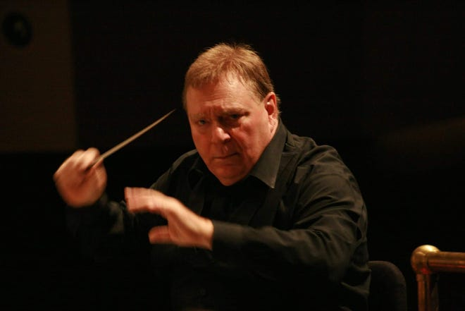 Gerhardt Zimmermann conducts the Canton Symphony Orchestra at a past performance. He will be leading the orchestra on Sunday during its first in-person concert since the pandemic. Tickets also can be purchased for virtual viewing.