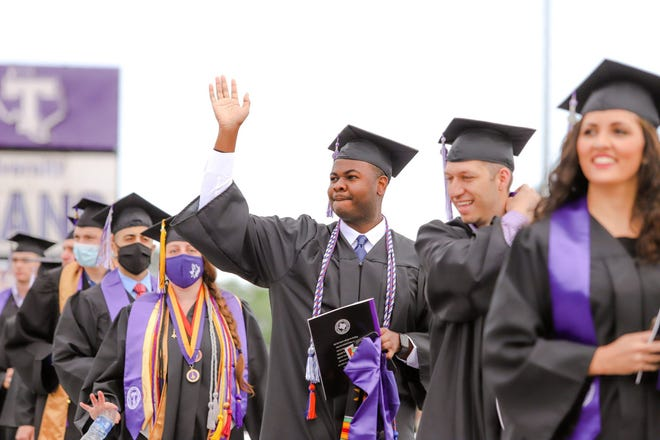 Graduates of Tarleton's College of Business, and College of Health Sciences and Human Services line up to receive their diplomas during Friday morning's commencement ceremony.