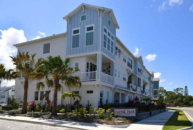 """Villas at Payne Park Village is a new development of two- and three-story villas, along School Avenue just south of Ringling Boulevard, in downtown Sarasota. The neighborhood features attached """"city homes,"""" single-family garden homes and paired villas."""