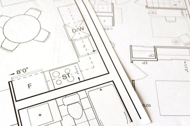 A photo of a floor plan to be constructed.