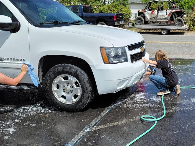 Students at Grenada helped wash staff member and teacher vehicles on Friday.