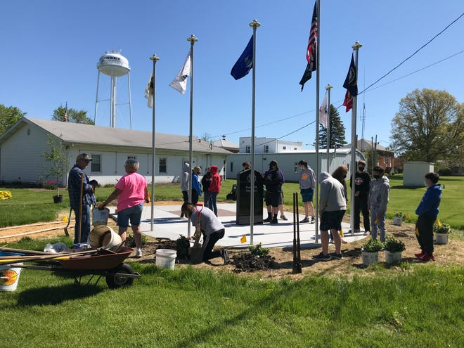 Neponset's eighth-grade class recently helped with the landscaping work at the village's new veteran's memorial.
