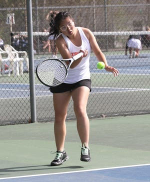 Amy Chen of Sturgis hits a return shot in her match at the conference championships in Allegan on Saturday.