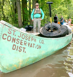 Volunteers at a river cleanup event in August 2019. This season's cleanup series begins June 5, with additional sessions scheduled in June, July and August.
