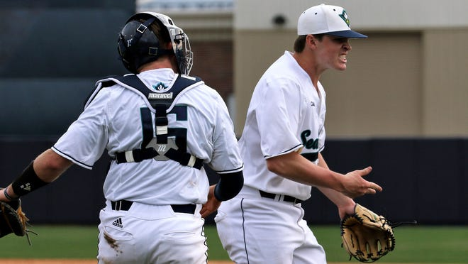 Former New Hanover baseball standout Hunter Hodges (right) has entrenched himself in the UNCW bullpen as a true freshman.