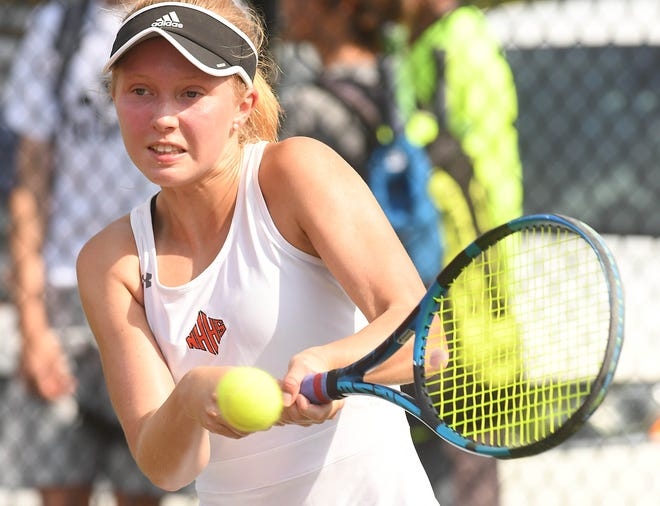 New Hanover's Peyton Philemon took on Hoggard's Elizabeth Vollmin as New Hanover played Hoggard in Tennis Monday May 17, 2021 in Wilmington at New Hanover.  [KEN BLEVINS/STARNEWS]