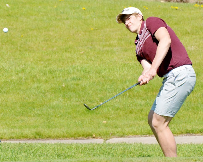 Jett Becker of Aberdeen Christian chips to the No. 7 Red green on Monday during the Pre-Region 1B high school golf tournament at Cattail Crossing Golf Course.