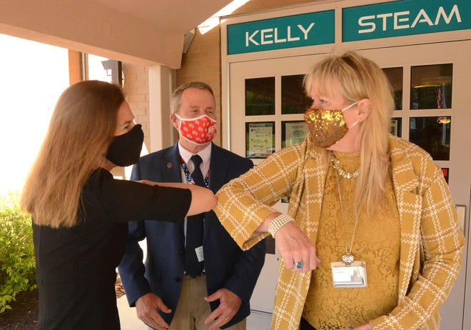 Lt. Gov. Susan Bysiewicz, left, greets Kristen Sringfellow, Norwich superintendent of schools, Monday before Pfizer COVID-19 vaccinations are given to 12- to 15-year-old students at Kelly STEAM Magnet Middle School in Norwich. At center is Norwich Mayor Peter Nystrom.