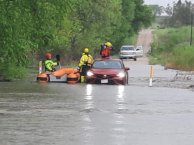 Firefighters rescued a man from atop the roof of a partially submerged car Sunday in eastern Wabaunsee County.