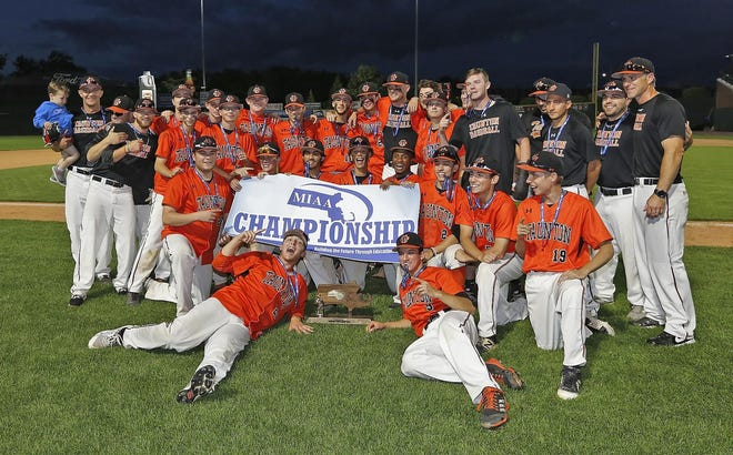 Members of the Division I state baseball champion Taunton High Tigers