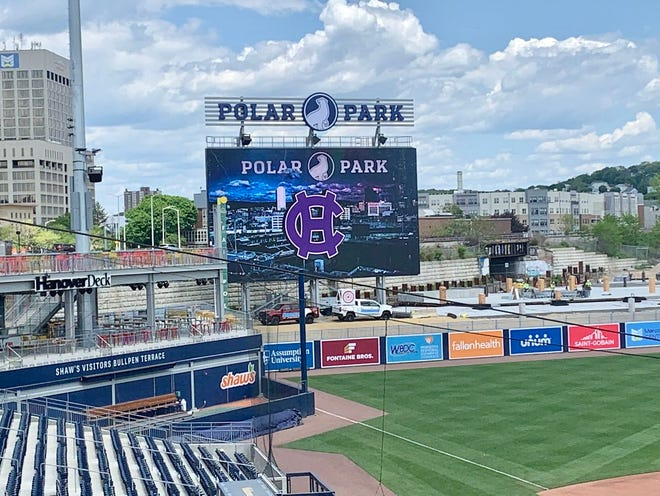 The scoreboard at Polar Park welcomes the Holy Cross football team.