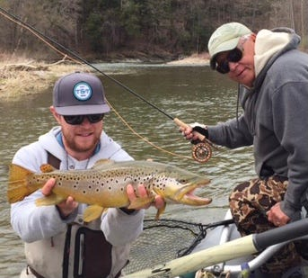 Jim Bender with an enormous Hoosic River brown trout being released by guide Eric Gass.