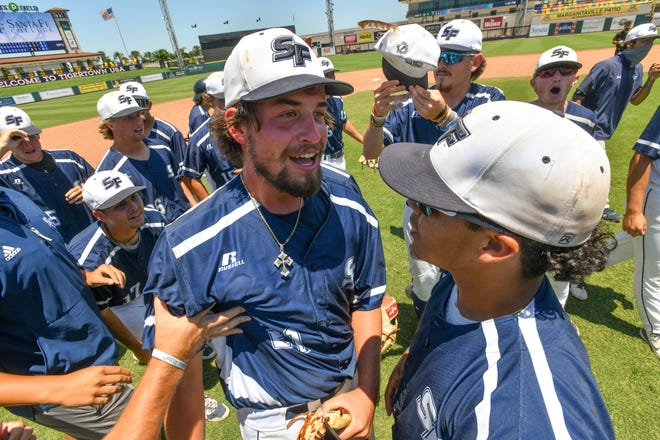 Santa Fe College pitcher Robb Adams (21) celebrates with teammates after his no-hitter against Northwest Florida State College in the FCSAA State Tournament on May 9 in Lakeland. [Tom Hagerty/Polk State College]