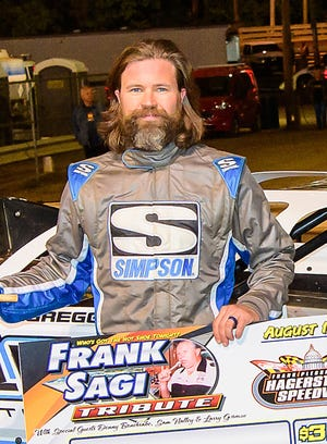 Gregg Satterlee celebrates in victory lane Sunday night at Hagerstown Speedway.
