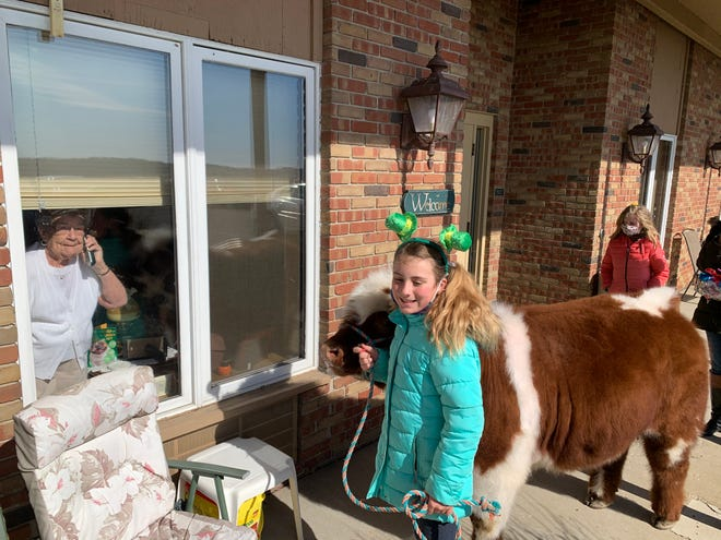 Layton Immel had some four-legged help in sharing the love.