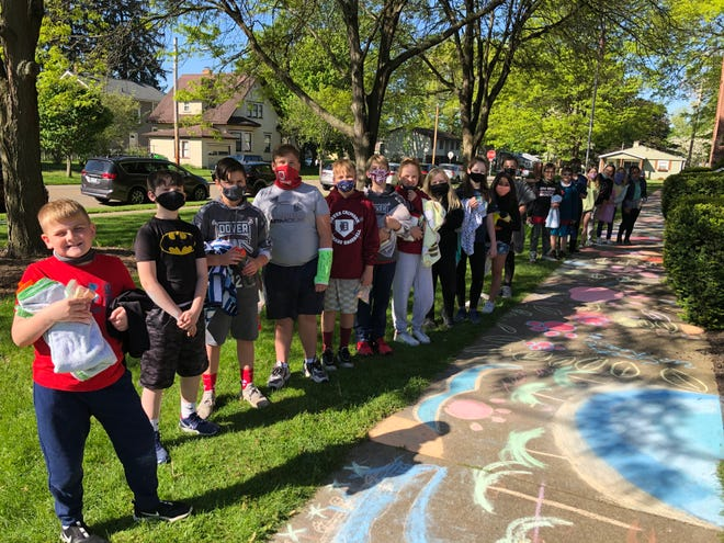 Fifth grade students at Dover Avenue Elementary participated in the 10th annual Chalk Walk on Friday. Dover First Moravian Church, and its pastor, John Wallace, sponsor the event.