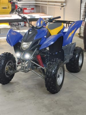 Engineering students converted a gas-powered ATV to run on electric power.