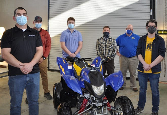 Engineering technology students converted a gas-powered ATV to electric power as their capstone project at Kent State University at Tuscarawas. Shown, from left to right, are Chris Miller, John Meek, Alex Denney, Sam Gross, Dave Schlosser (instructor) and Michael Leshon.