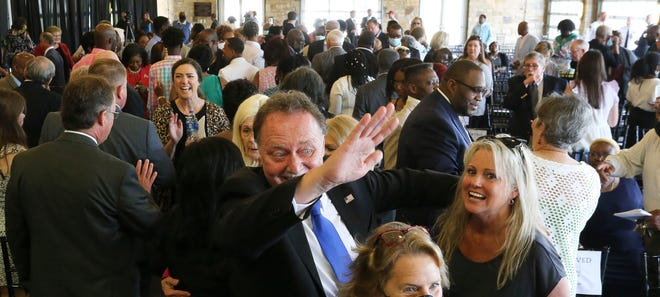 Kip Tyner, the new Tuscaloosa City Council president, waves to a supporters following the Inauguration Ceremony at Tuscaloosa River Market. Members of the Tuscaloosa City School Board and Tuscaloosa City Council were sworn in Monday, May 17, 2021. [Staff Photo/Gary Cosby Jr.]