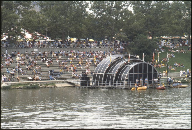 A floating riverfront amphitheater was dedicated May 24, 1974, during the 13th annual Greater Columbus Arts Festival. The amphitheater was on the west bank of the Scioto River south of Discovery Bridge in what now is Genoa Park. The Columbus Symphony Orchestra performed a dedication concert later that evening. This amphitheater existed until a more permanent version was built to accompany the new COSI building, which opened Nov. 6, 1999.