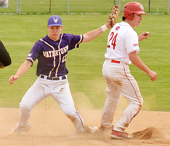 Watertown Post 17 shortstop Jerod Cryus awaits the call after tagging Rapid City Post 22's Dalton Klosterman on a stolen-base attempt during their American Legion baseball doubleheader Sunday at Watertown Stadium. Klosterman was safe on the play.