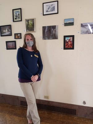 Kate Miller, children's librarian, with some of the photos.
