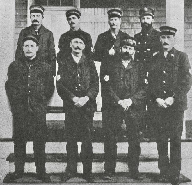 """Edward L. Clark, first row, far right, is shown  during what he called """"some of the happiest years he spent in the Lifesaving Service and the Coast Guard service,"""" at the Monomoy Point Lifesaving station, around 1902."""