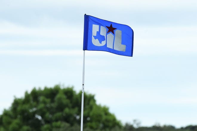 A UIL state tournament flag waves in the wind during the first round of the Class 5A boys state golf tournament Monday at the White Wing Golf Club in Georgetown.