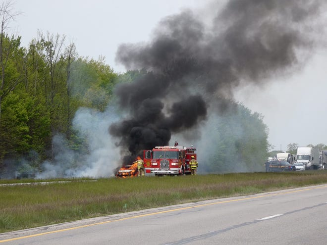 Crestline firefighters extinguish a vehicle that caught fire Monday morning in the eastbound lane of US 30 near the Crawford and Richland county line.