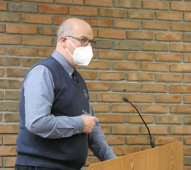 Bucyrus Mayor Jeff Reser wears a mask while speaking at a Bucyrus City Council meeting in early March. Reser announced Monday he was lifting the mask requirement for vaccinated people entering city buildings.