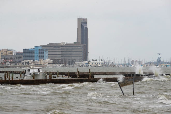 Waves crash into a seawall in Corpus Christi Bay on Monday, May, 17, 2021. Weather officials say the Corpus Christi area is in for rain for at least the next three days.