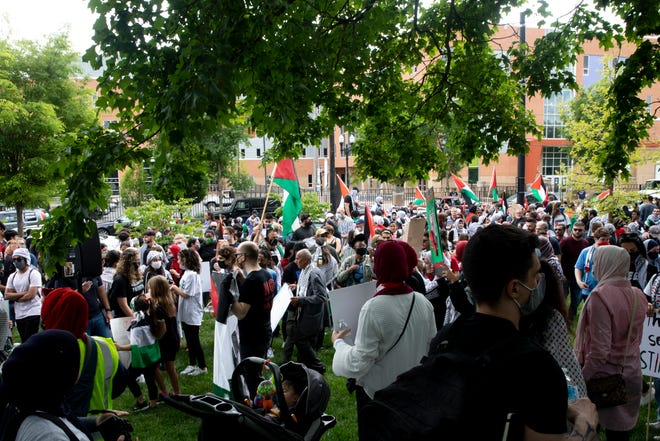 People protest Israeli aggression against Palestinians at Washington Park in Over-The-Rhine on Sunday, May 16, 2021.