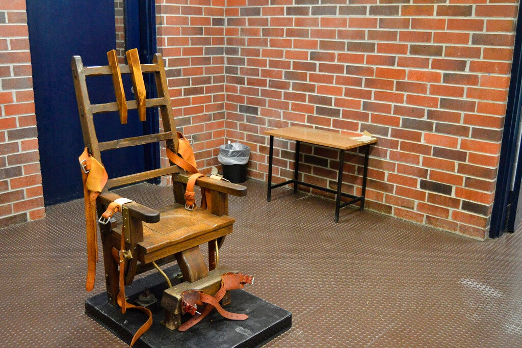 New law makes inmates choose electric chair or firing squad 2