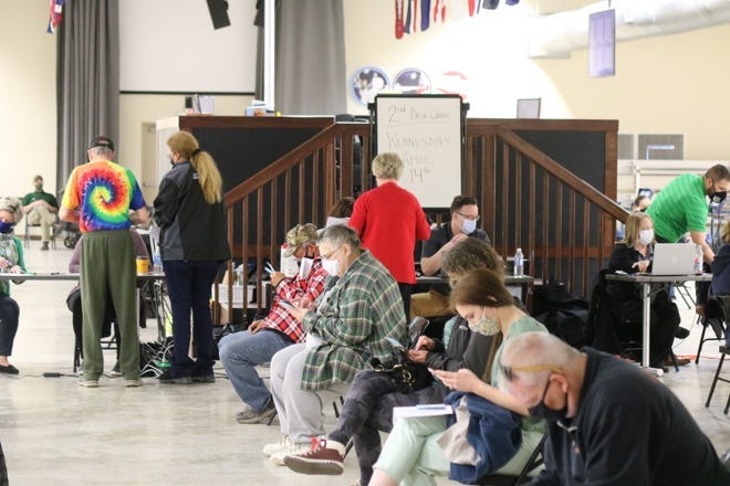 Ottawa County residents wait to get vaccinated in March at a clinic held at Camp Perry. The county is now at orange on the state's COVID-19 heath advisory system after a significant drop in cases.